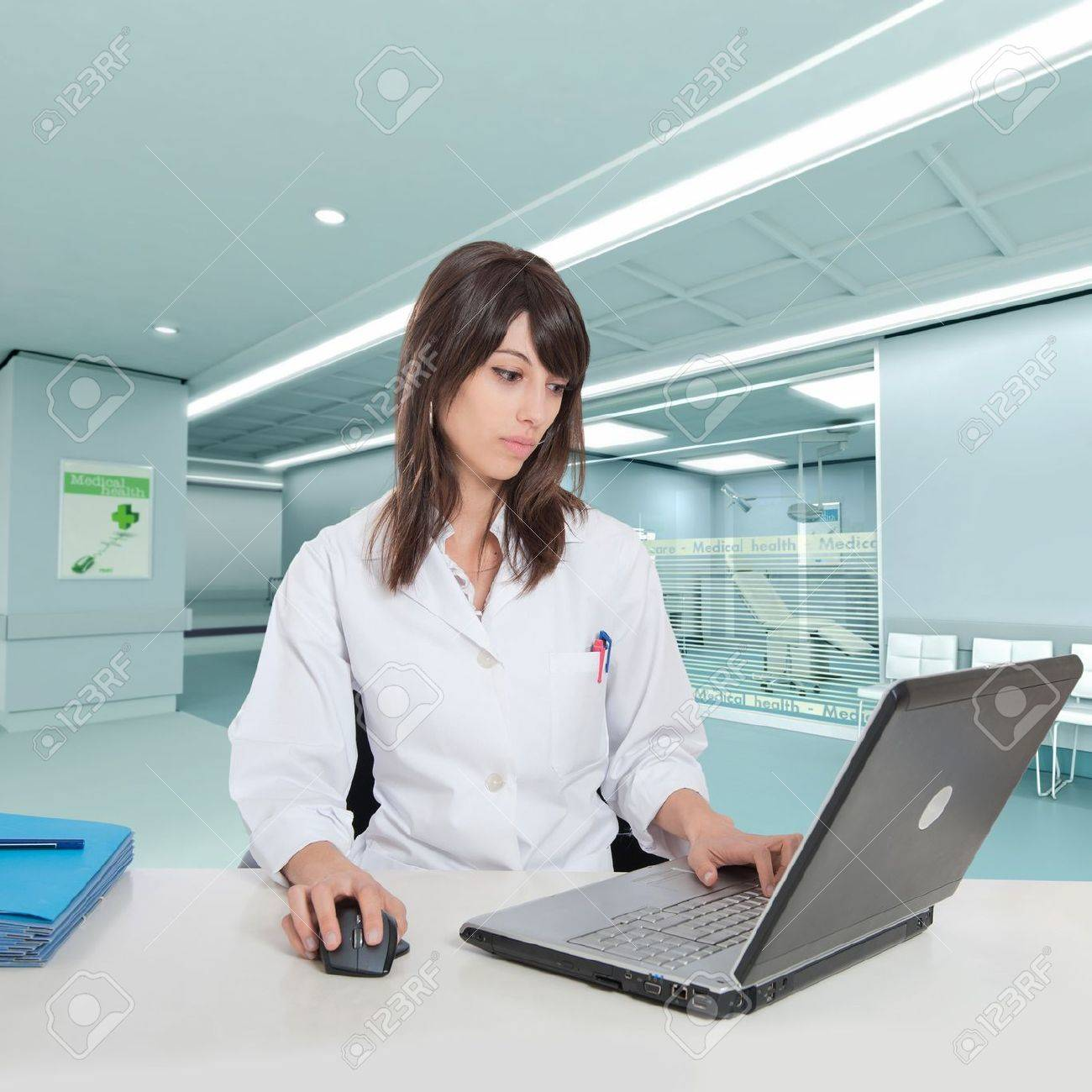 Young female hospital administrative in a desk at the hospital hall Stock Photo - 9947857
