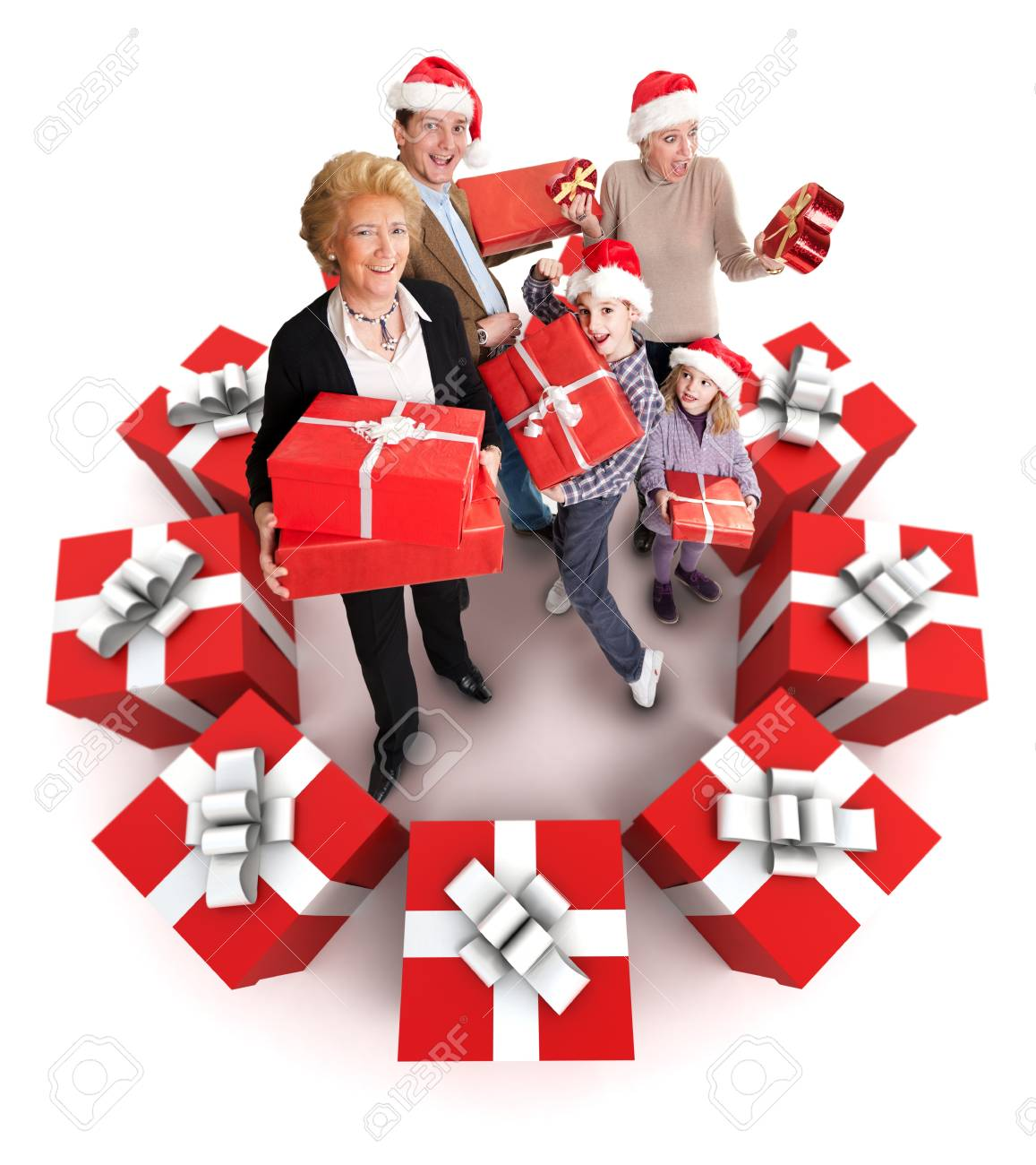 Happy family with Santa�s hats surrounded by gifts Stock Photo - 13734523