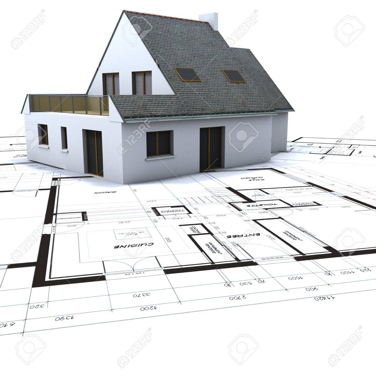 Architectural model on top of architect s blueprints against a white background Stock Photo - 15941663