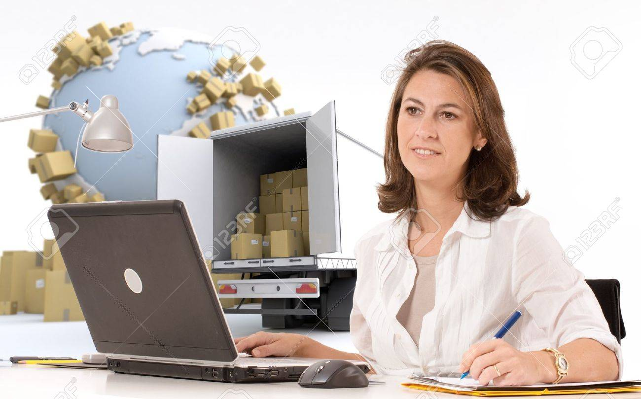 Friendly woman at her desk  in an international transportation context Stock Photo - 20993499