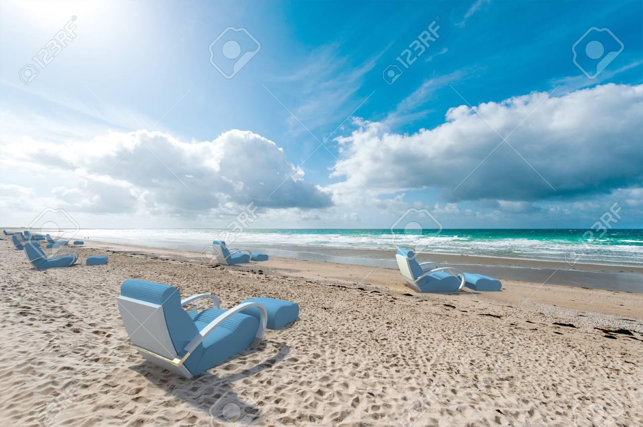 Relaxing sofas on a beach, facing the sea Stock Photo - 22277341