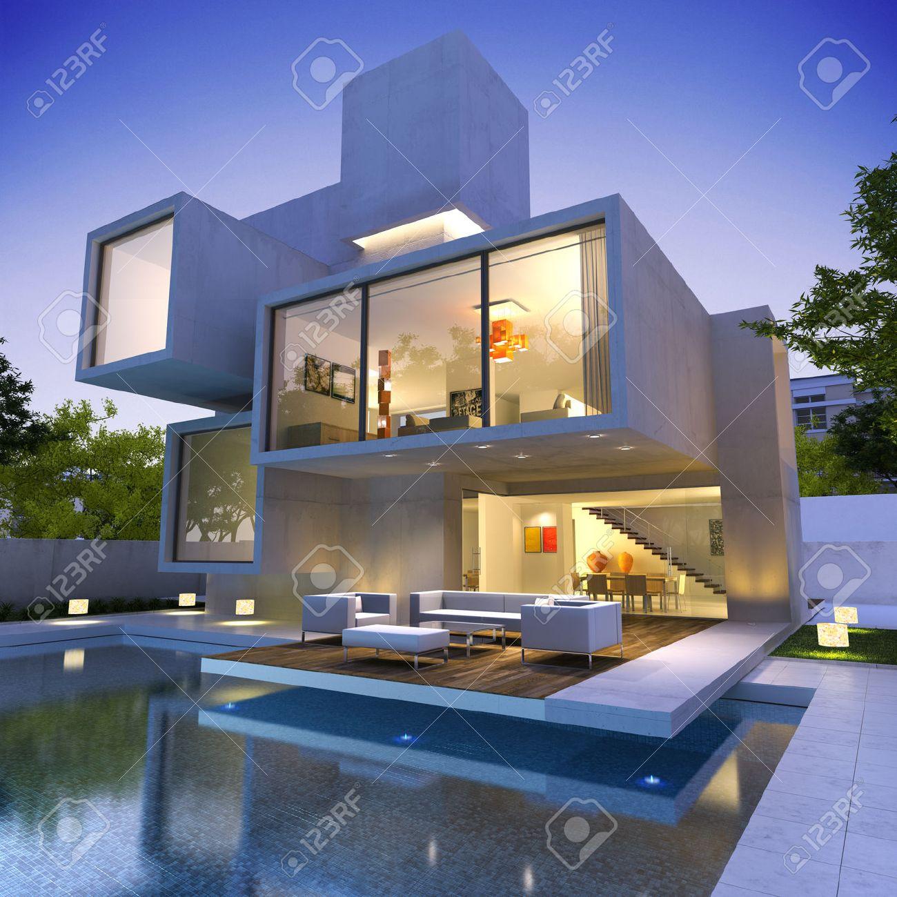 Veduta esterna di una casa contemporanea con piscina al tramonto ...