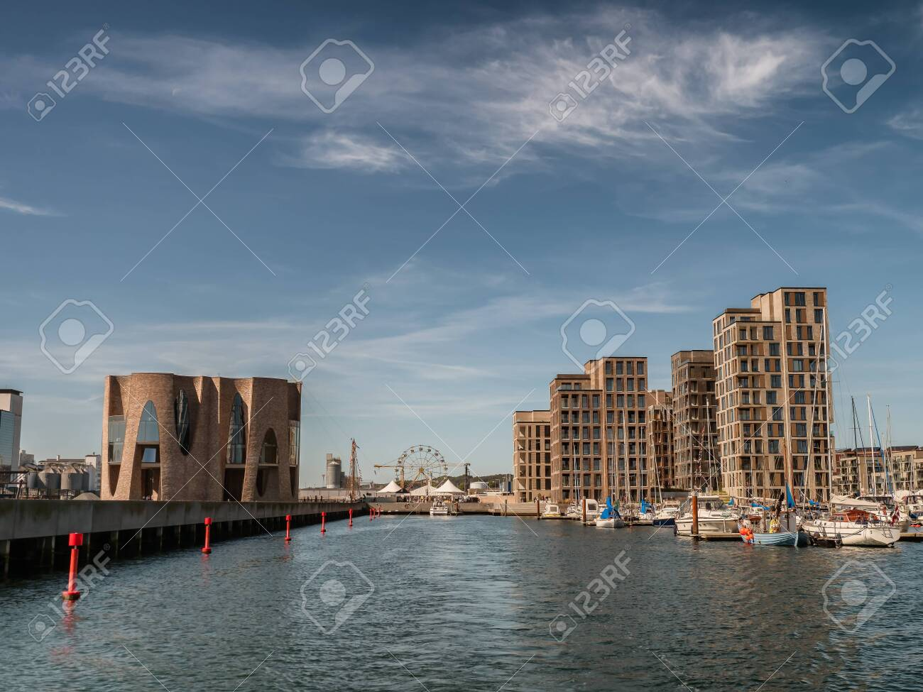 Vejle inner marina harbor with modern apartments and small boats, Denmark - 129152033