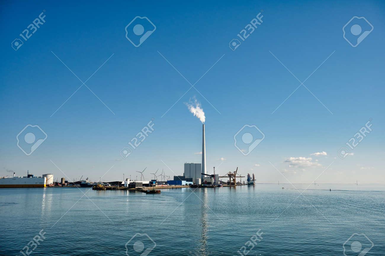 Wind power rigs in Esbjerg harbor. Denmark - 165753705