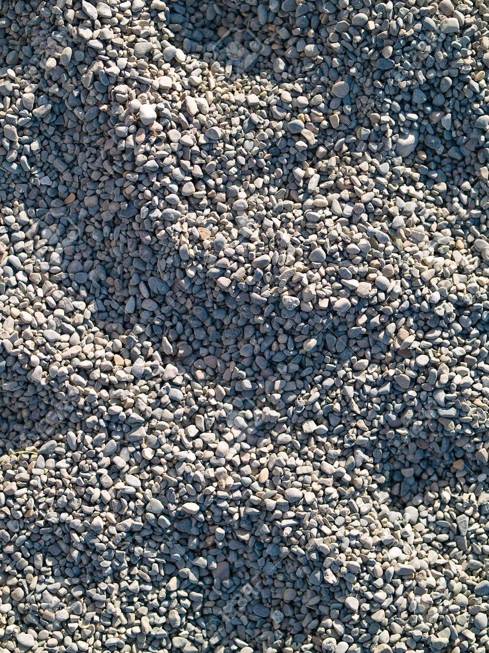 pea gravel playground play area stock photo sunlit playground pea gravel with shadows and footprints playground pea gravel with shadows and footprints