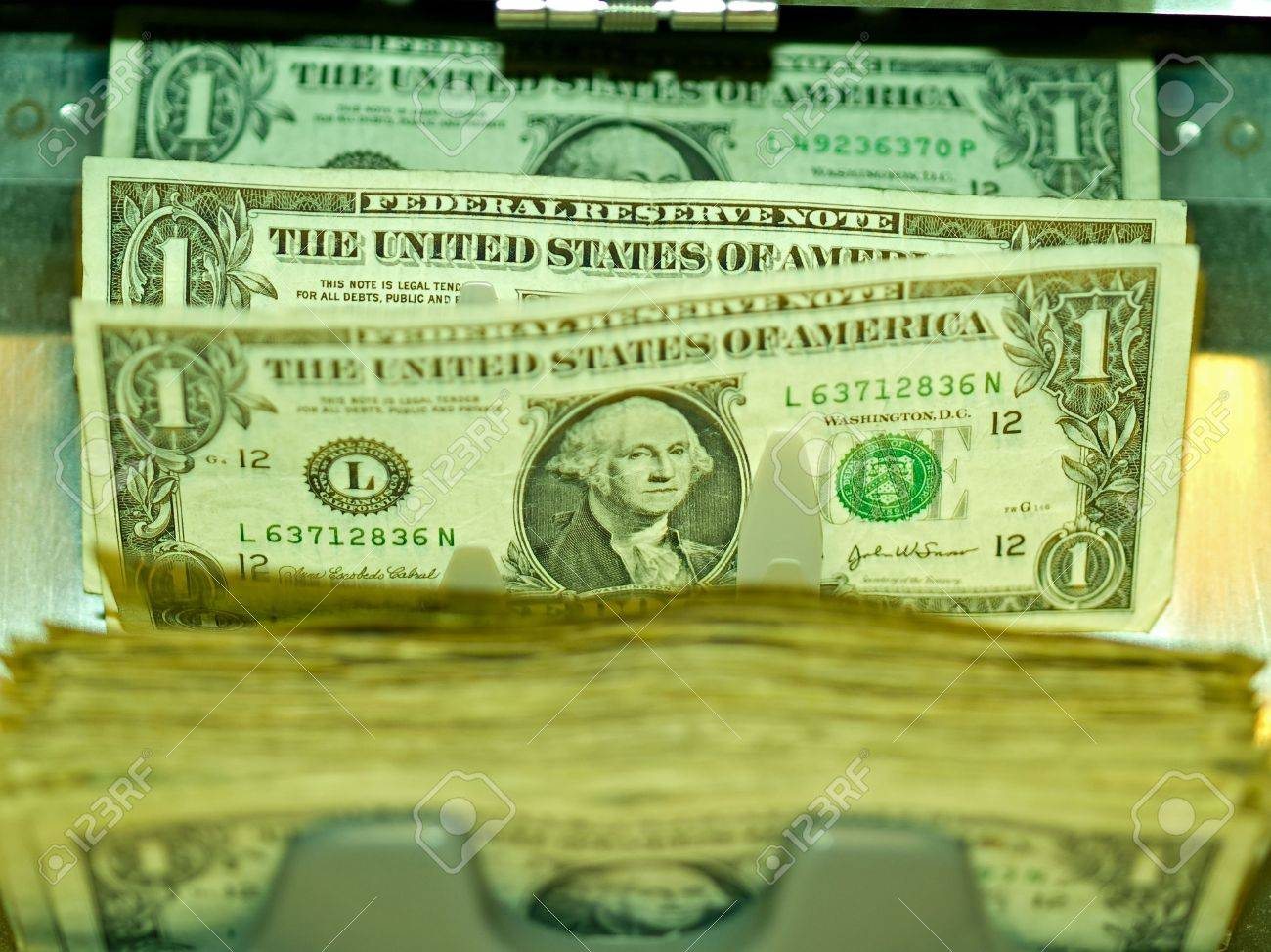 An electronic money counter processing US $1 bills Stock Photo - 6407734