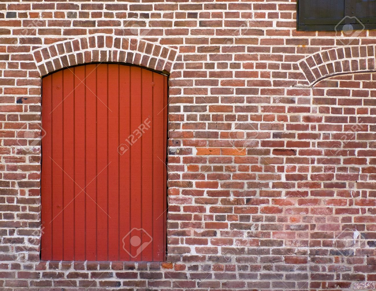 Red Brick Wall with a Red Door and Window Stock Photo - 7948116