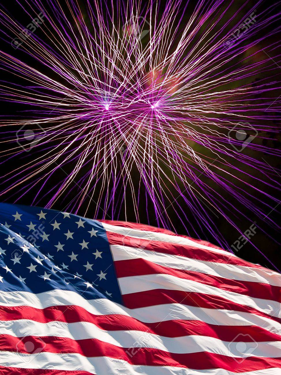 The American Flag And Purple Fireworks From Independence Day Stock