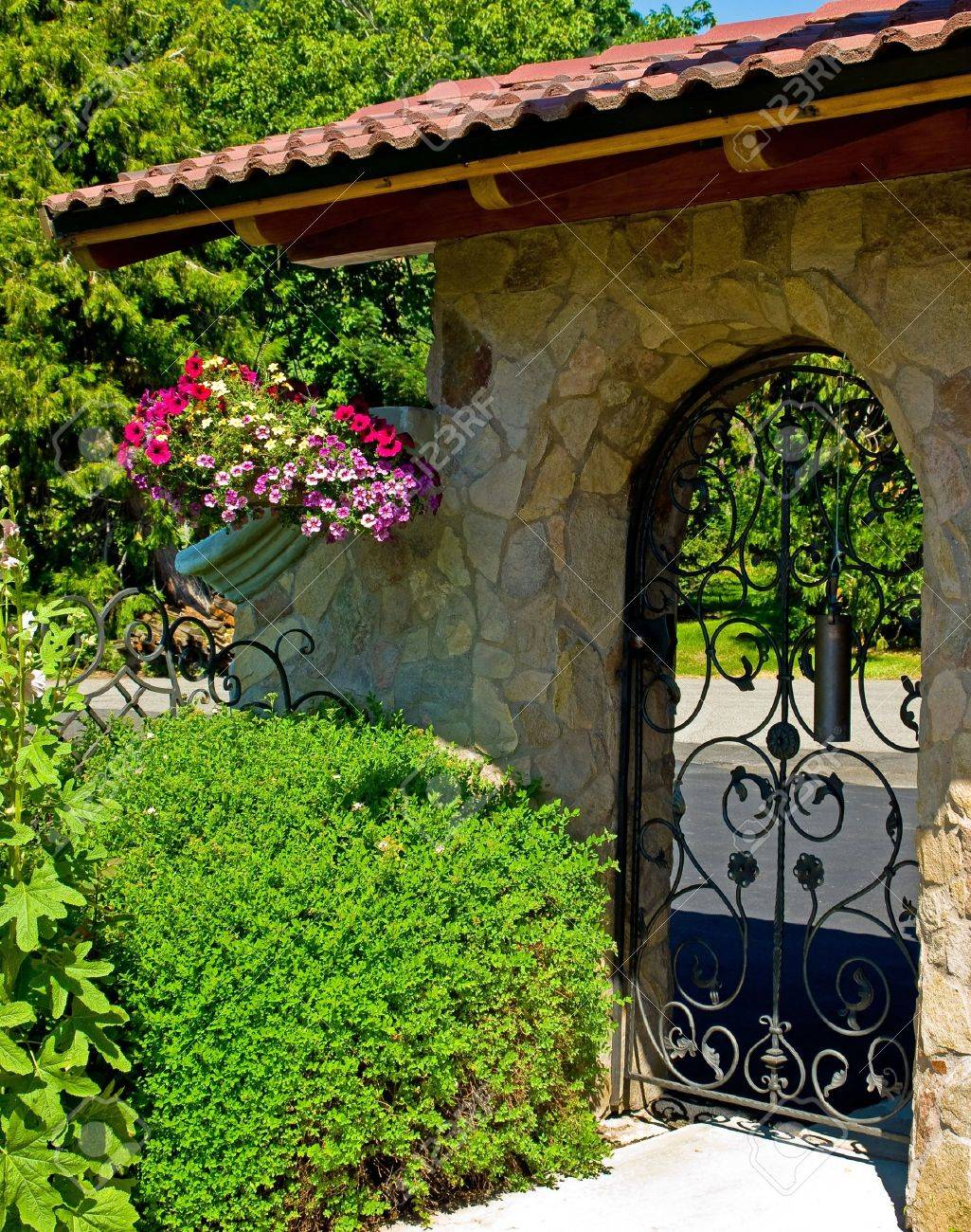 Iron garden gate - Garden Gate Wrought Iron Garden Gate In A Fancy Garden