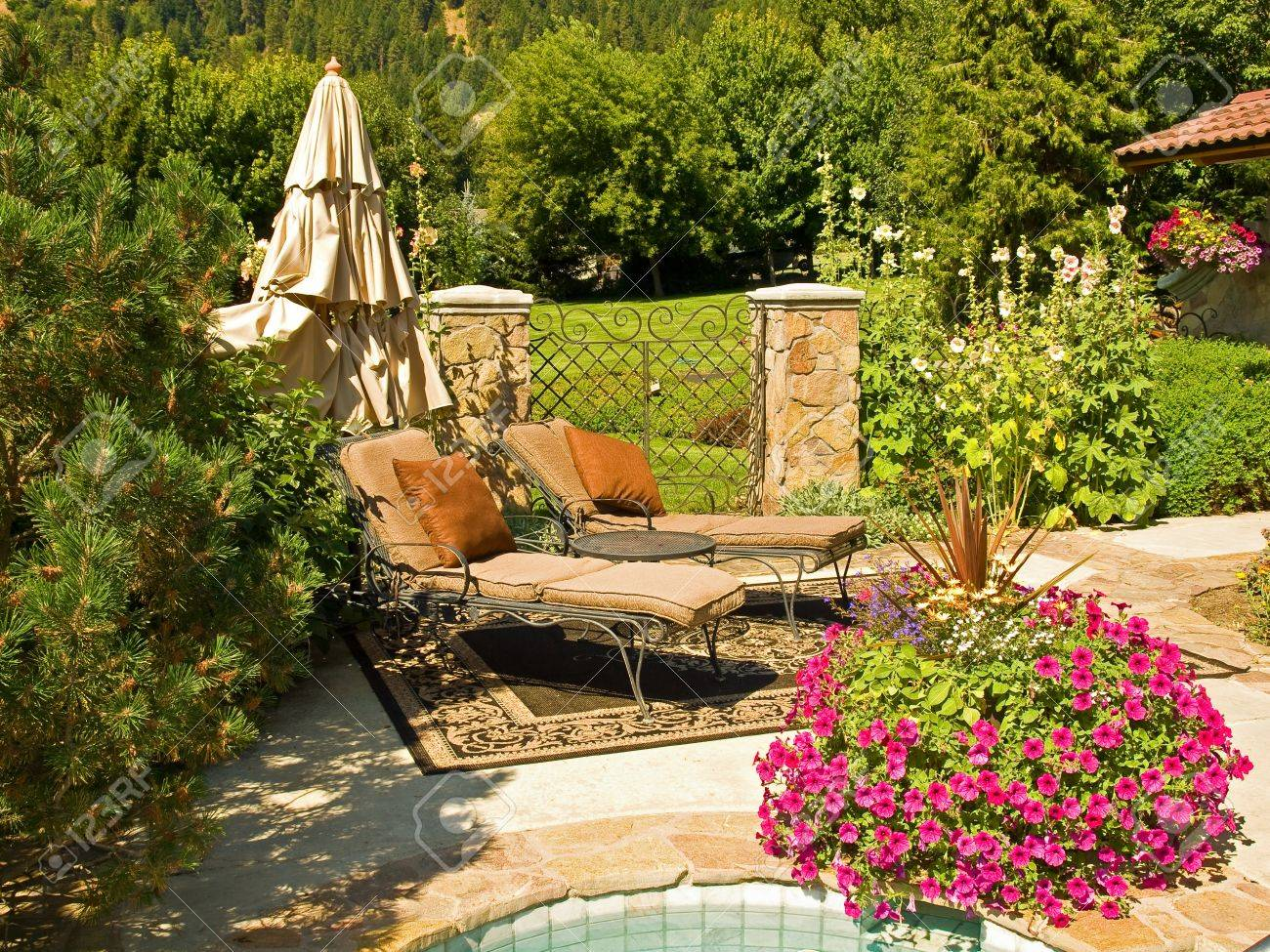 Two Empty Lounge Chairs in a Garden Setting Stock Photo - 10754561