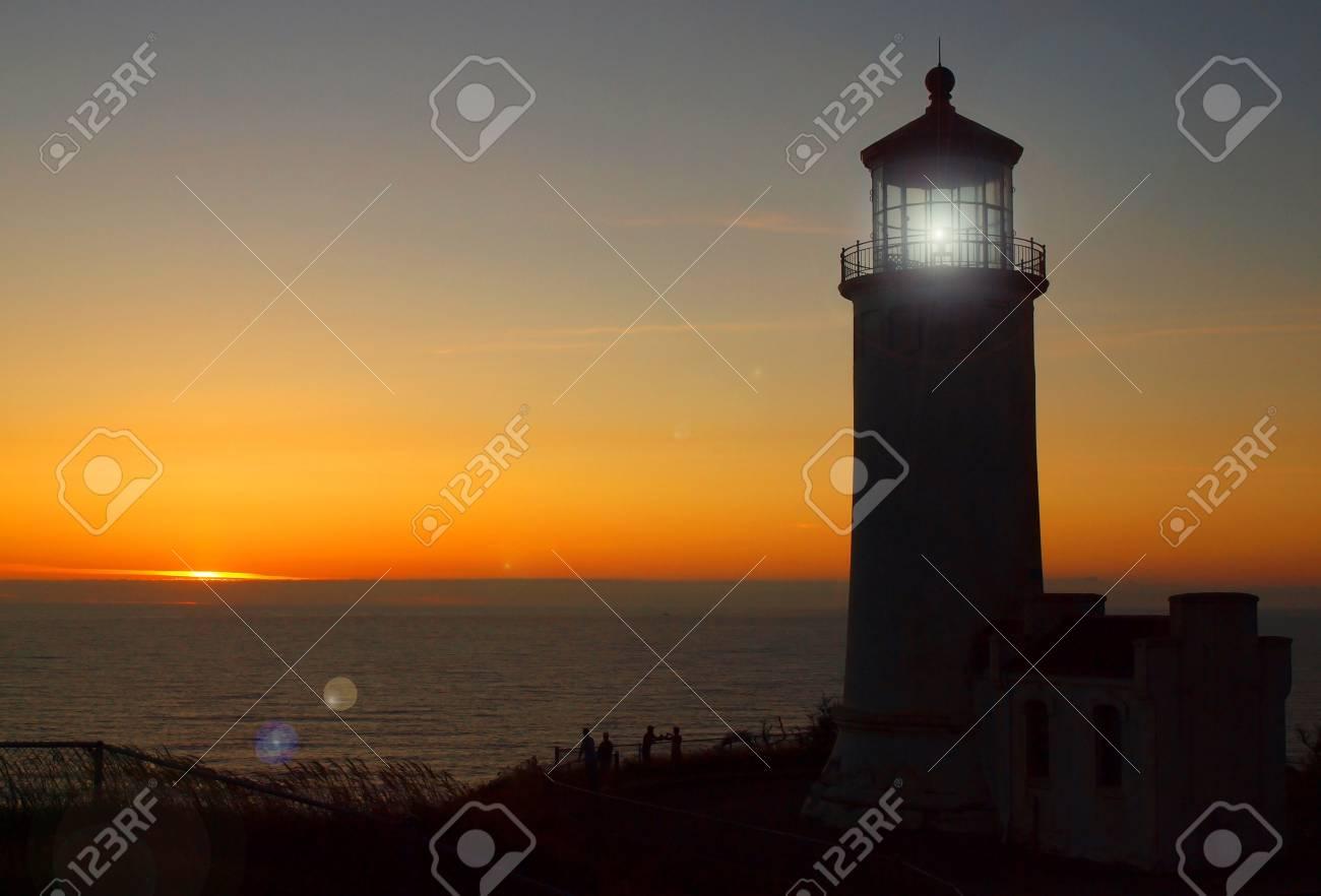 Light Shining in the North Head Lighthouse on the Washington Coast at Sunset Stock Photo - 10754354