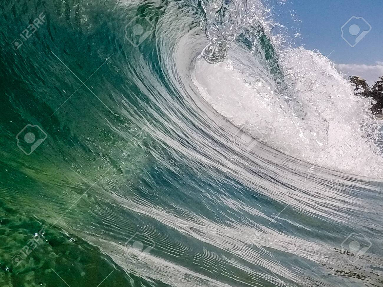 A wave breaks at the sea - 133776029