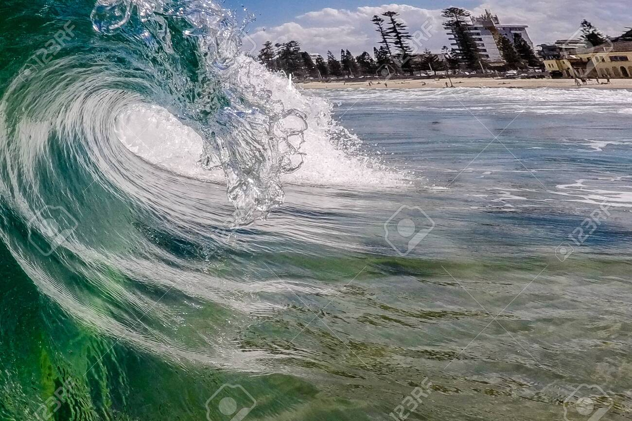 A wave breaks at the sea - 133776030