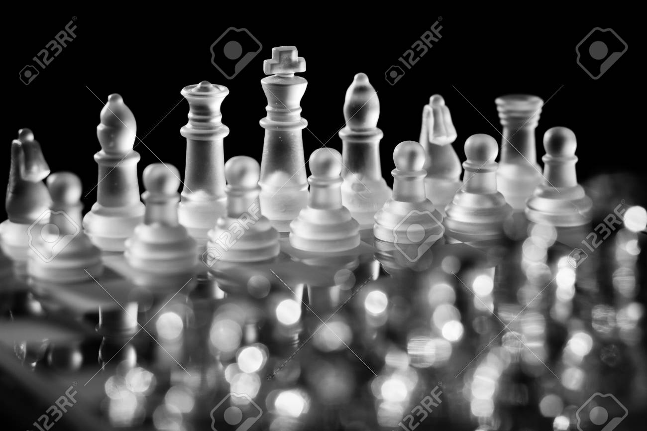 Glass Chess Board with Pieces Set Up And Ready for a Game Against