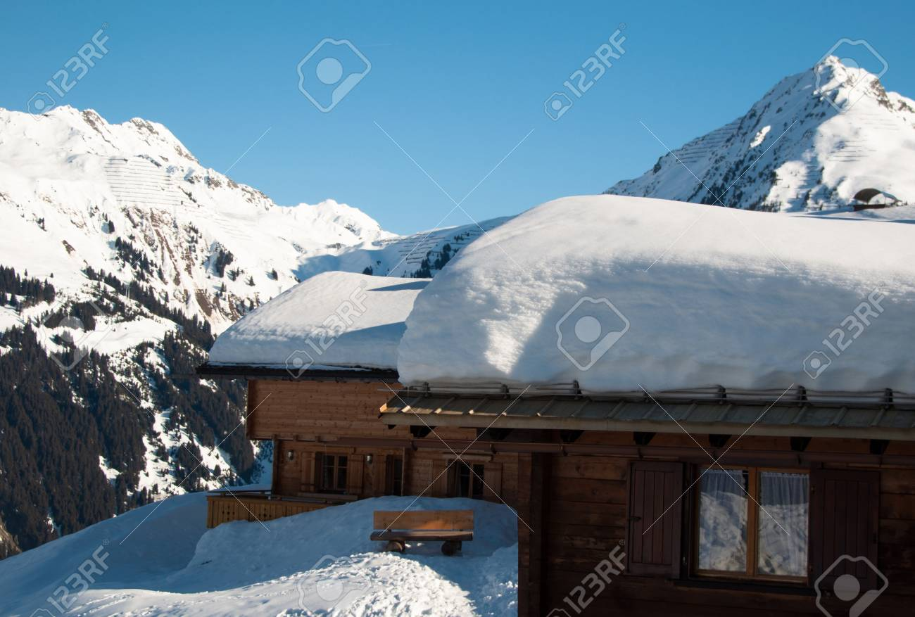 Small wooden huts covered with a lot of fresh snow in Montafon, Austria Stock Photo - 12774727