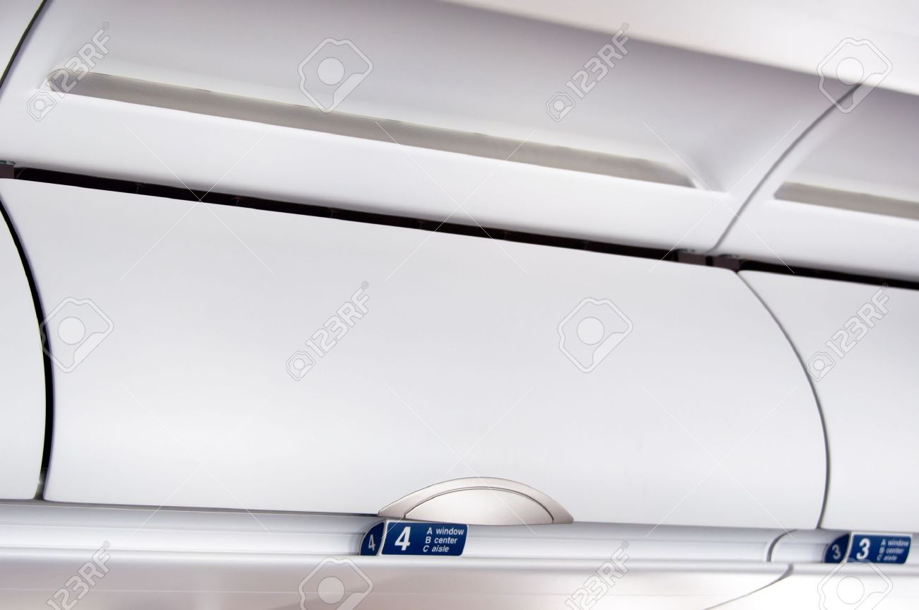 overhead compartment detail shot of an airplane cabin interior