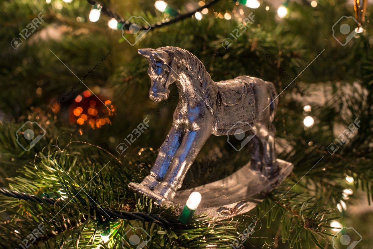Silver Rocking Horse Christmas Ornament On Christmas Tree Stock Photo   17500717