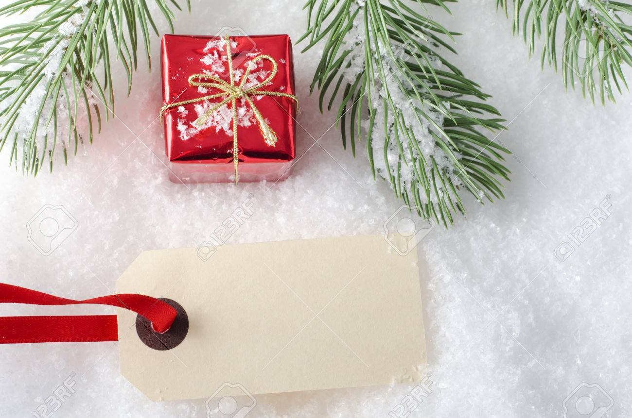 Overhead shot of a small Christmas gift box, with blank parcel..