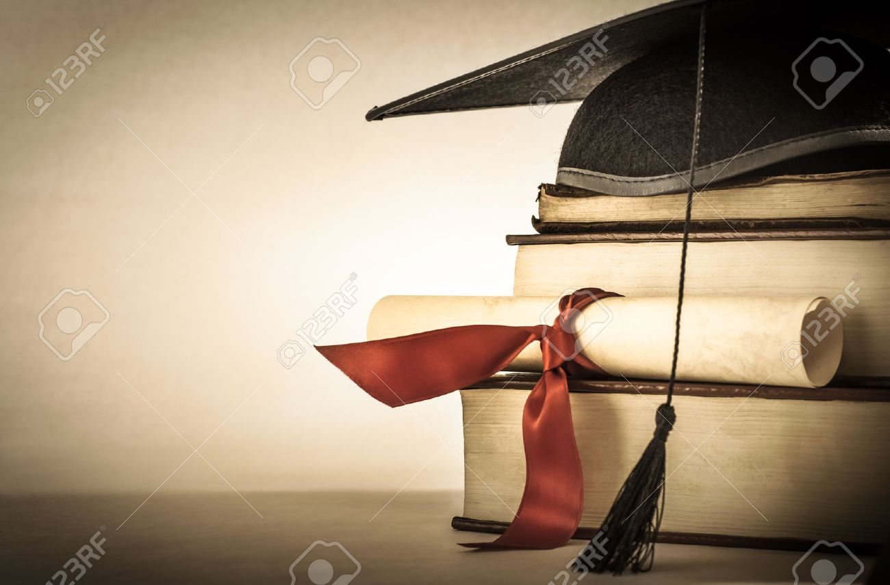 college graduation stock photos pictures royalty college college graduation a mortarboard and graduation scroll tied red ribbon on a