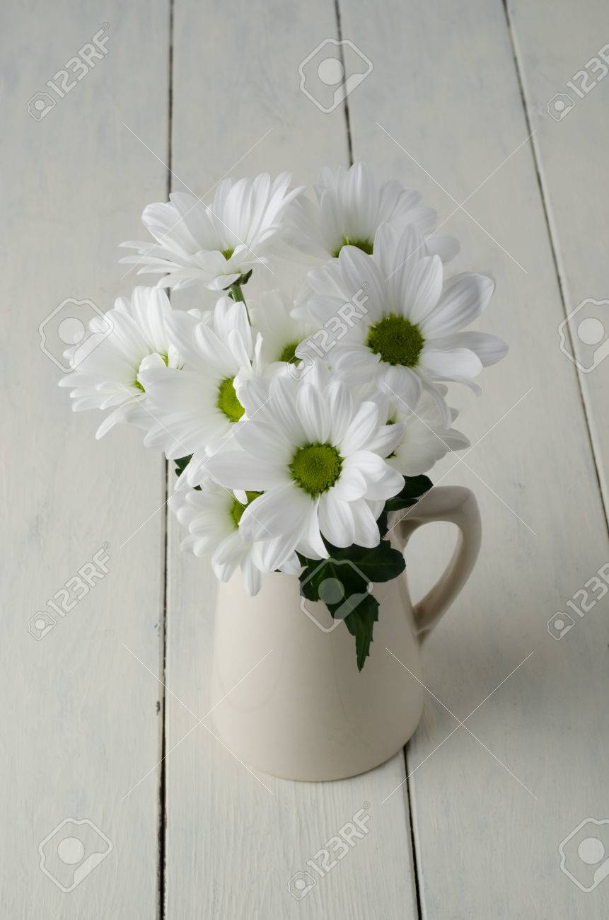 A Small Bunch Of White Flowers Chrysanthemums With Green Leaf