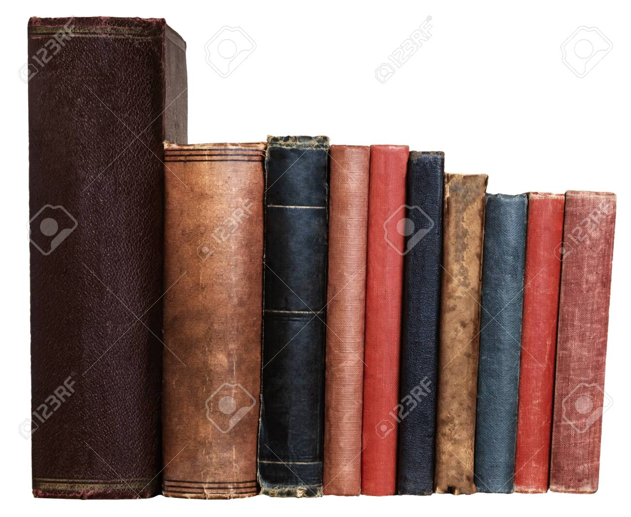 A row of old books in different colours and sizes, isolated on a white background. Blank spines facing viewer at eye level. - 139469578
