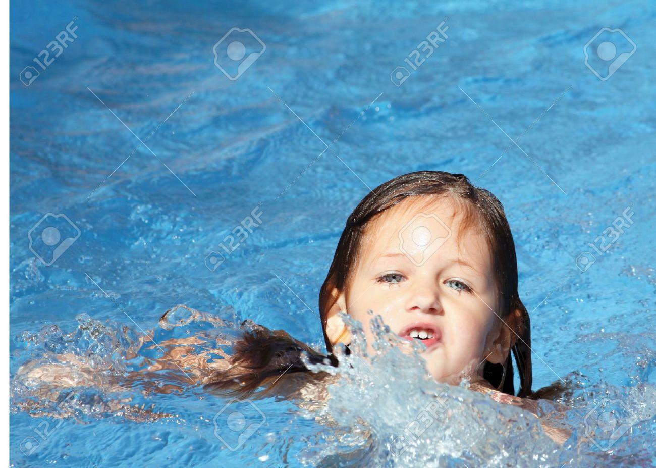 child trying to swim unaided Stock Photo - 5061760