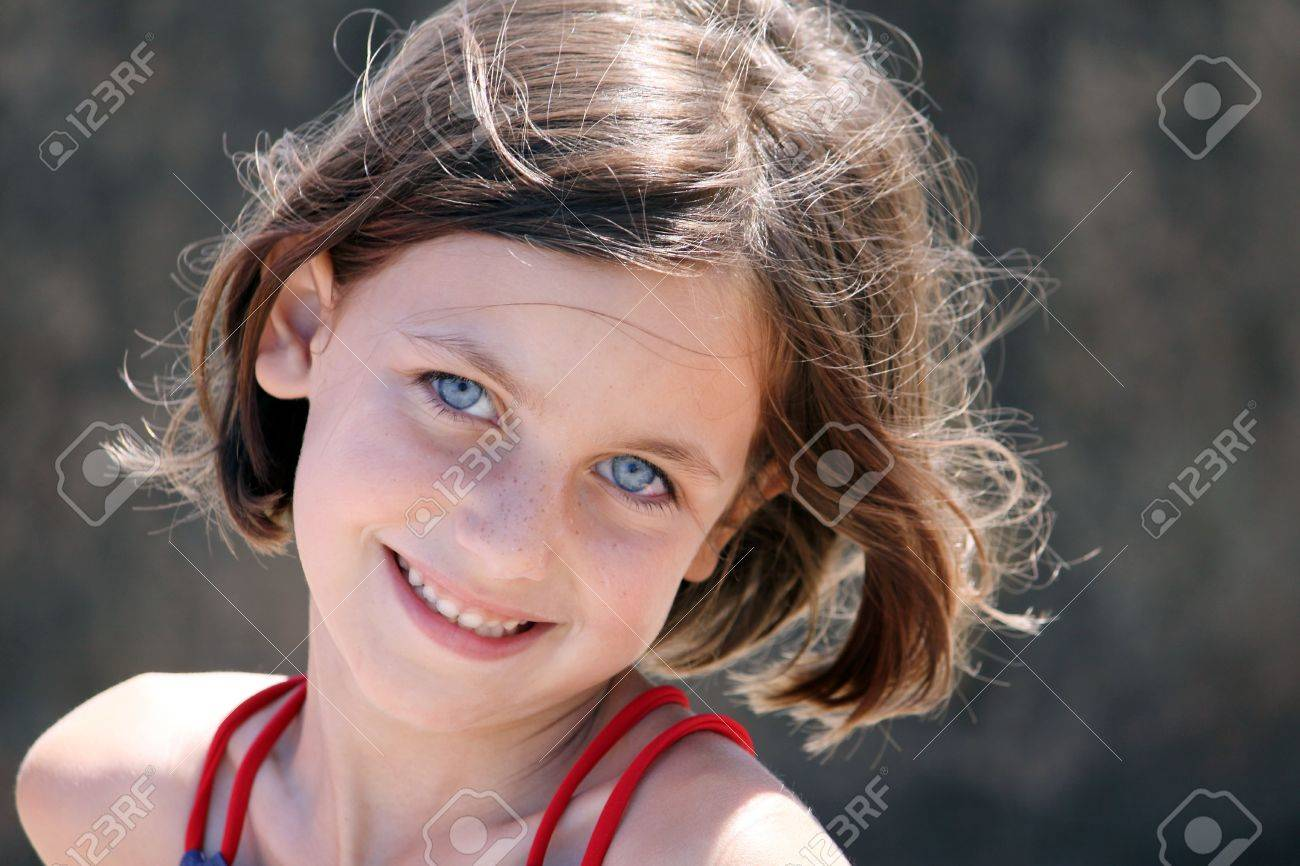 a portrait of a young girl with blue eyes smiling at the camera Stock Photo - 5218674