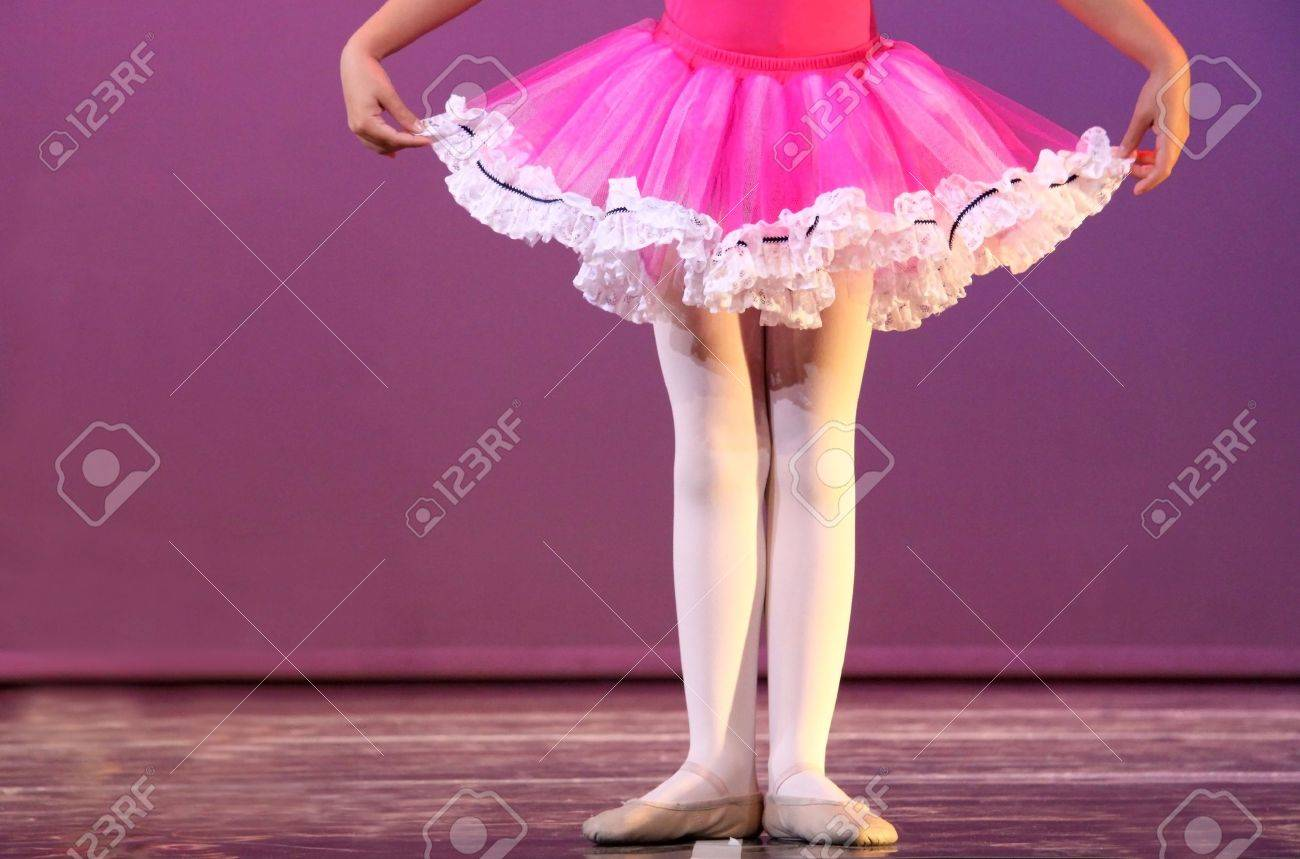 a young ballerina in first position rehearsing on stage Stock Photo - 6010828