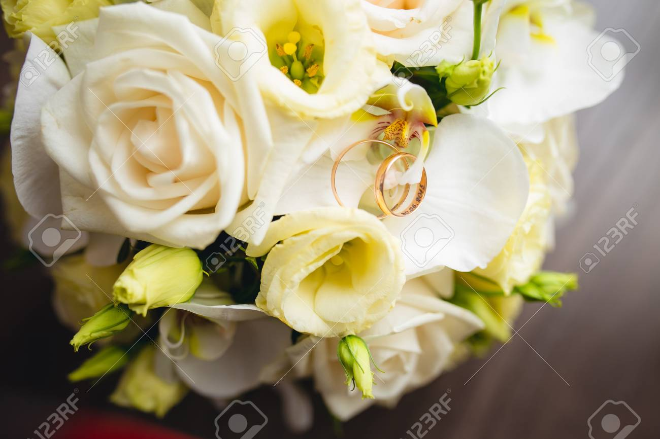 Gold Wedding Rings On A White Wedding Bouquet Stock Photo Picture