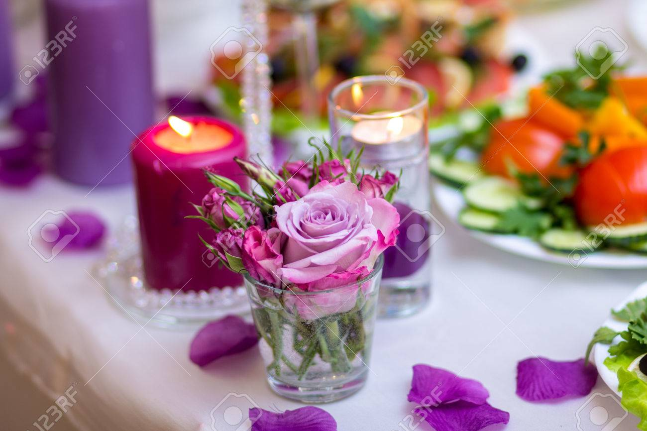 Wedding Table Decoration With Candle In Lilac Color Stock Photo