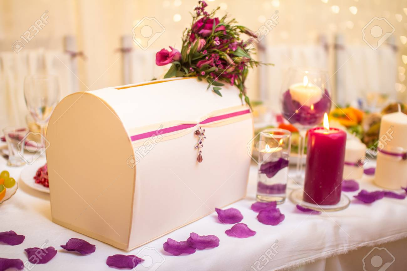 Wedding Table Decoration With Box In Lilac Color Stock Photo