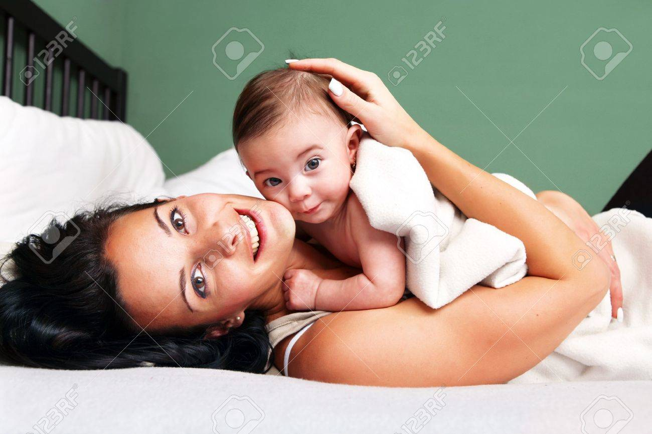 Portrait of happy woman with her baby Stock Photo - 12685065