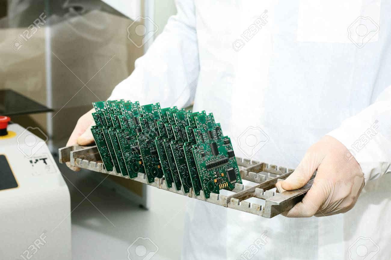 Technician With Computer Circuit Board Chips Spare Parts Of A And Components For Equipment