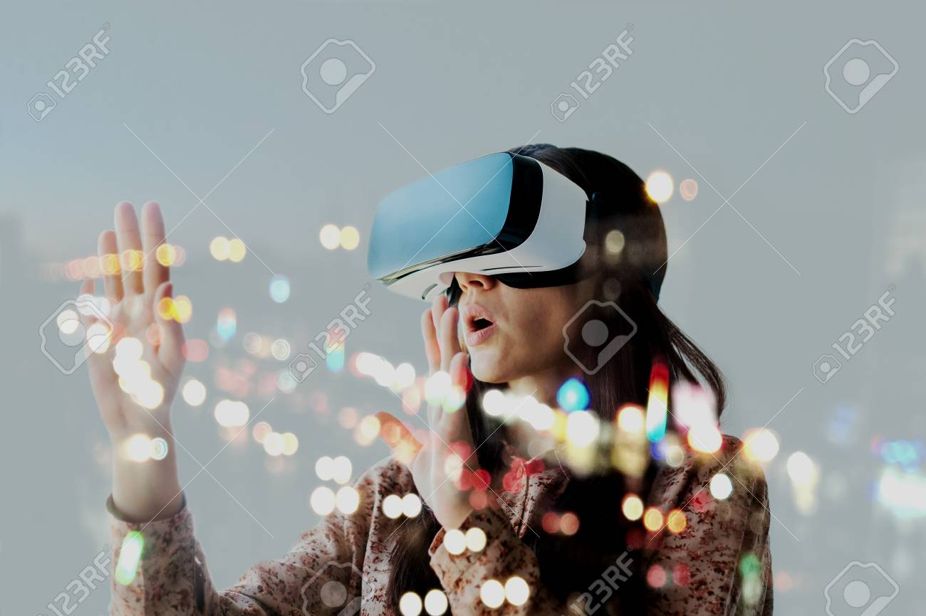 The woman with glasses of virtual reality. Future technology concept. Modern imaging technology. - 96914711
