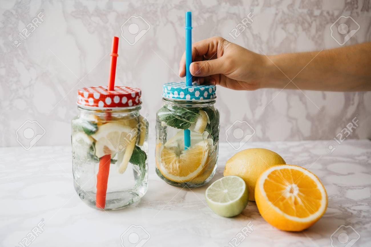 homemade citrus lemonade or juice or mojito in a jar drink from