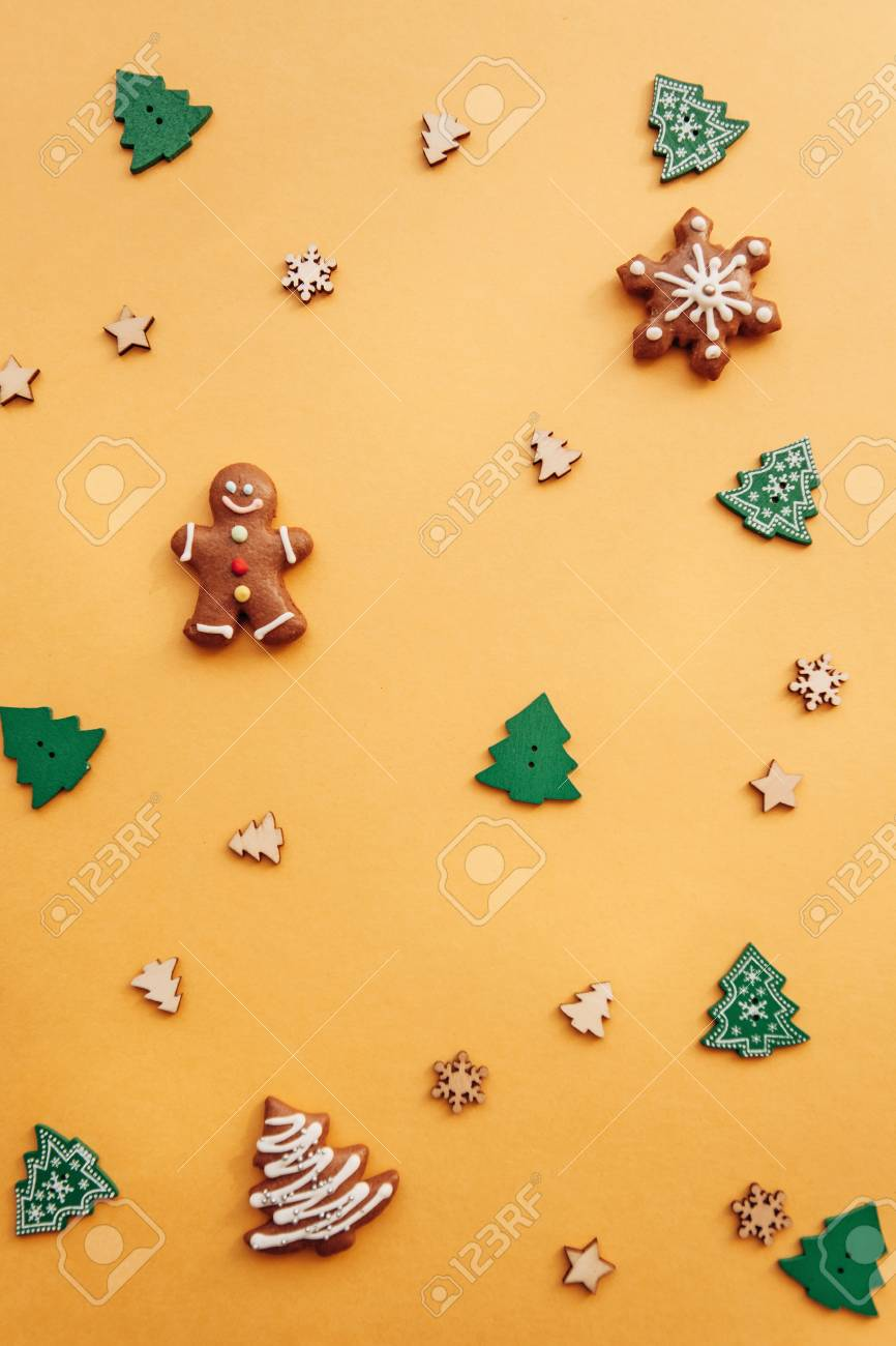 Christmas Or New Year Background With Gingerbread And Small Wooden Stock Photo Picture And Royalty Free Image Image 108824498