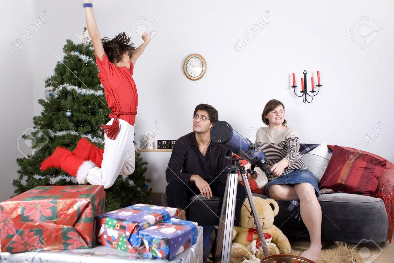 Happy Family Having Fun And Opening Gift At Christmas Time Stock ...