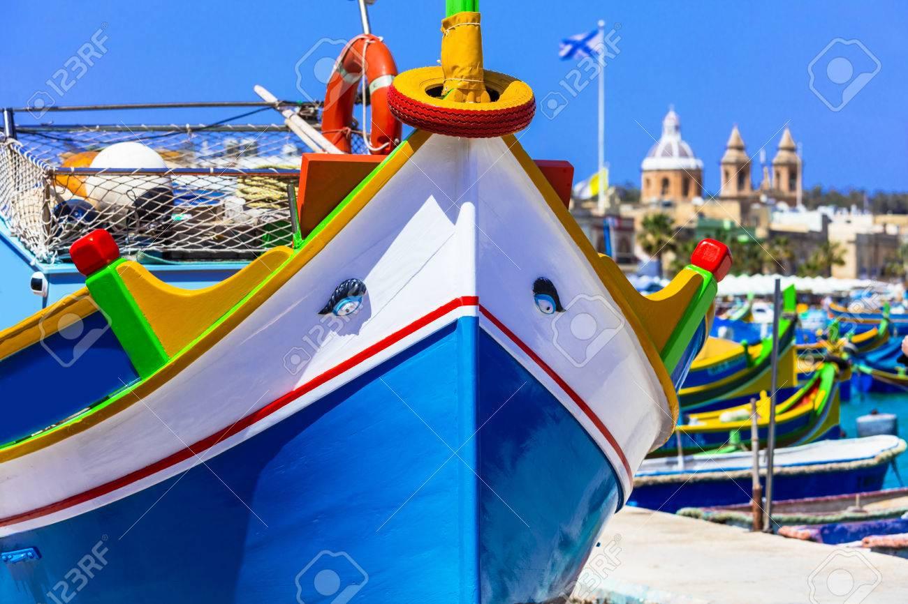 Malta - traditional colorful boats in Marsaxlokk village - 60068243