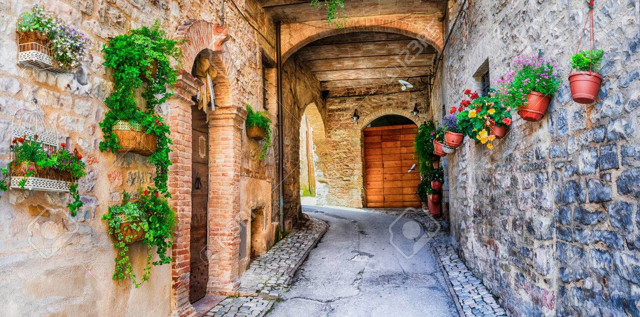 beautiful streets with floral decoration in Spello - medieval village in Italy - 62001027