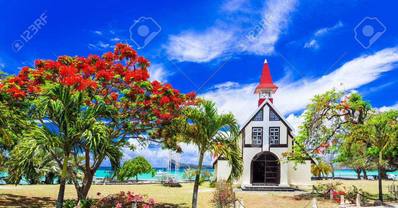 famous red church in Cap malhereux in Mauritius island and flamboyant tree - 70203649