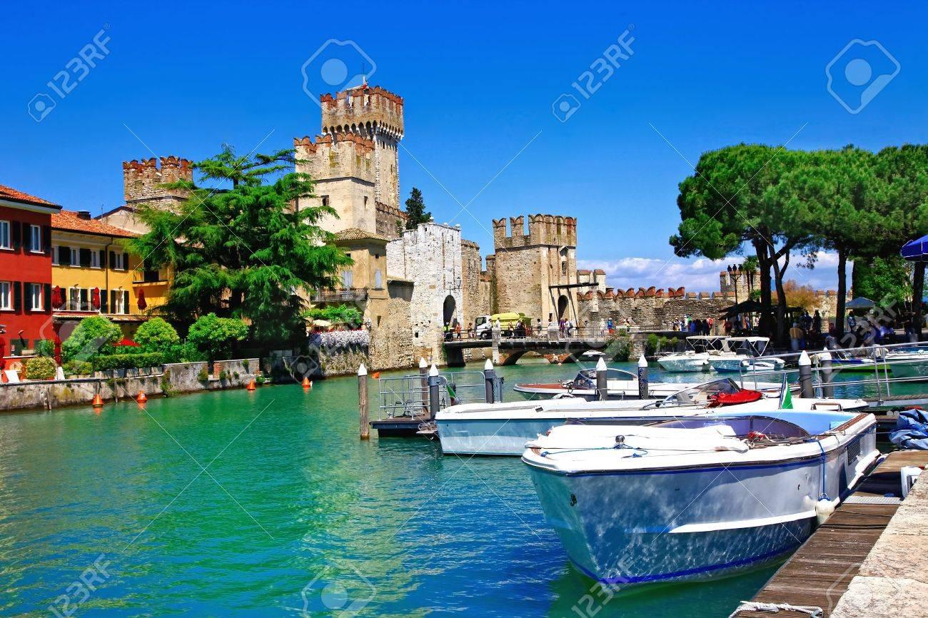 Beautiful Lake Garda, view of Rocca Scaligera in Sirmione village, Italy. - 75154845