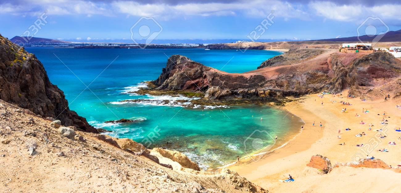 Volcanic landscape of Lanzarote island, Azure sea and incredible rocks, Canary, Spain. - 75242306