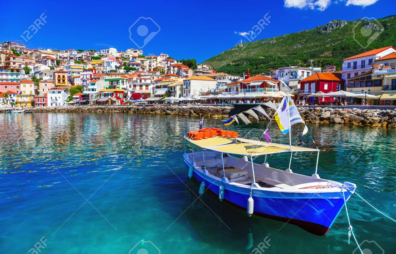 Beautiful Parga village, view with colorful houses and fishing boat, Greece. - 88573286