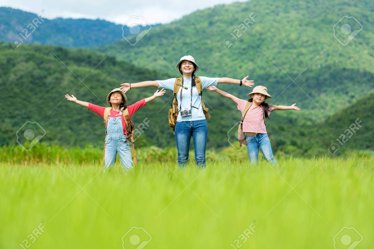 Group asian family children raise arms and standing see mountain outdoors, adventure and tourism for destination leisure trips for education and relax in nature park. Travel vacations and Life Concept - 130316246