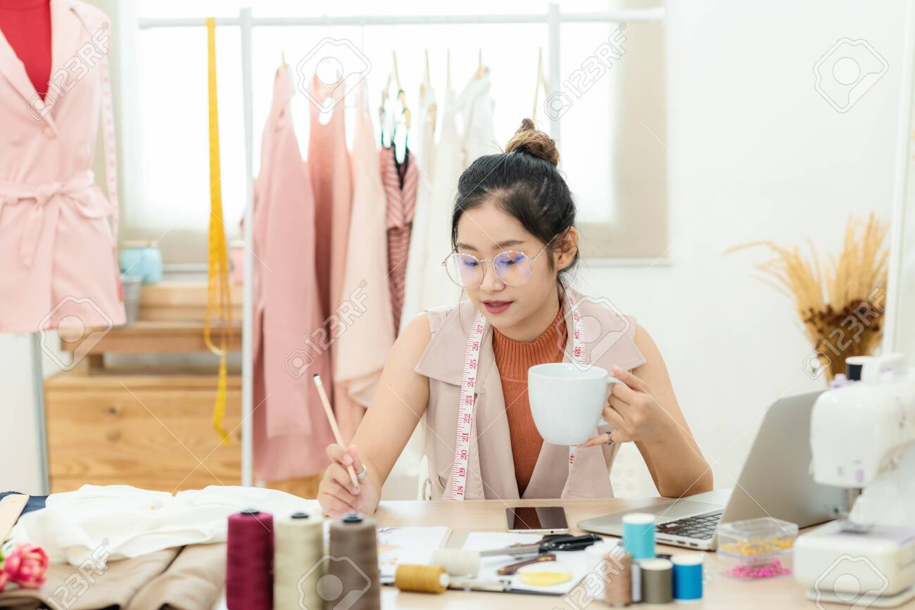 Work From Home Asian Young Woman Fashion Designer Working On Stock Photo Picture And Royalty Free Image Image 147030781
