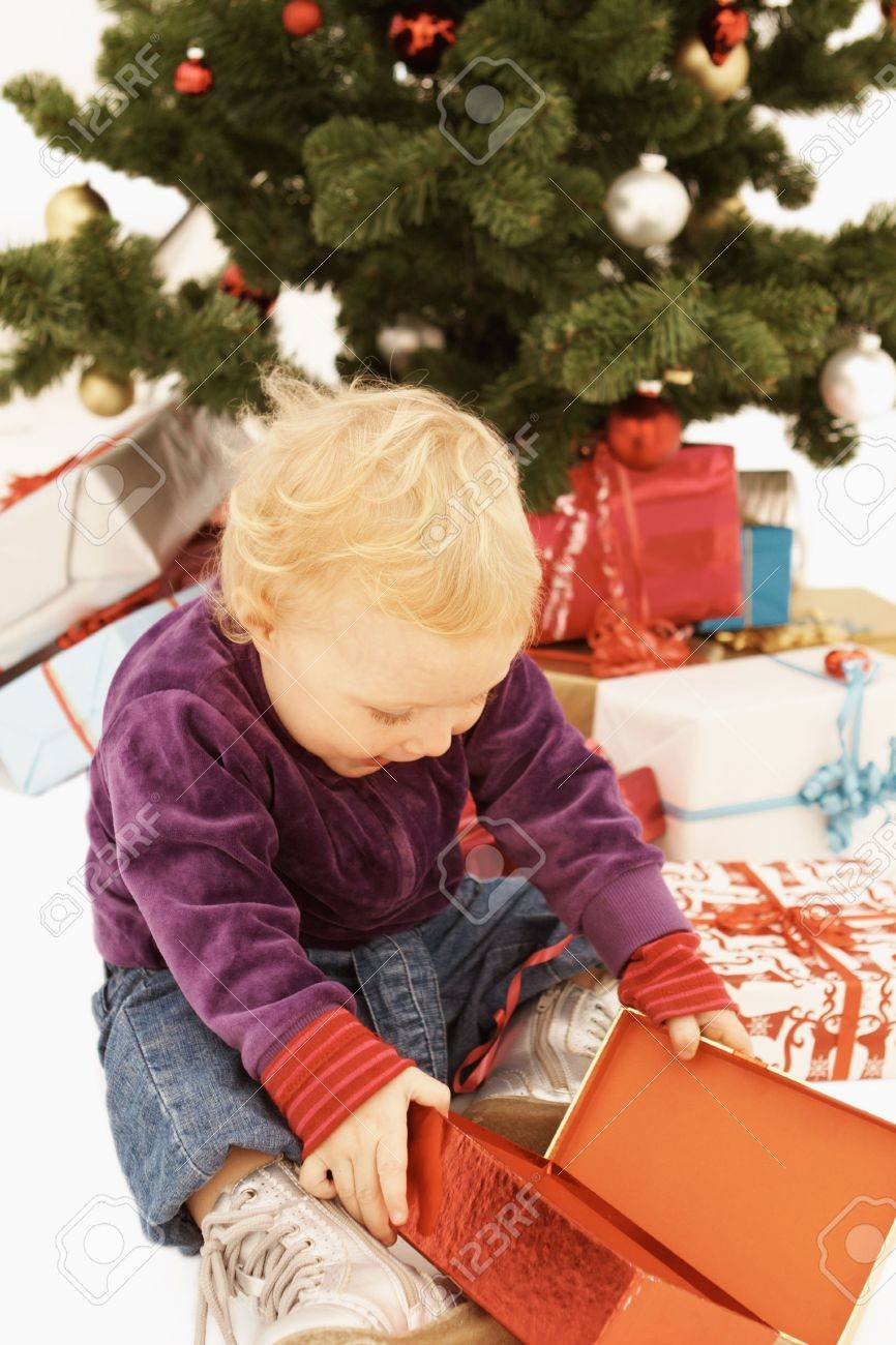 Wow - Surprised kid opening christmas presents Stock Photo - 6109625