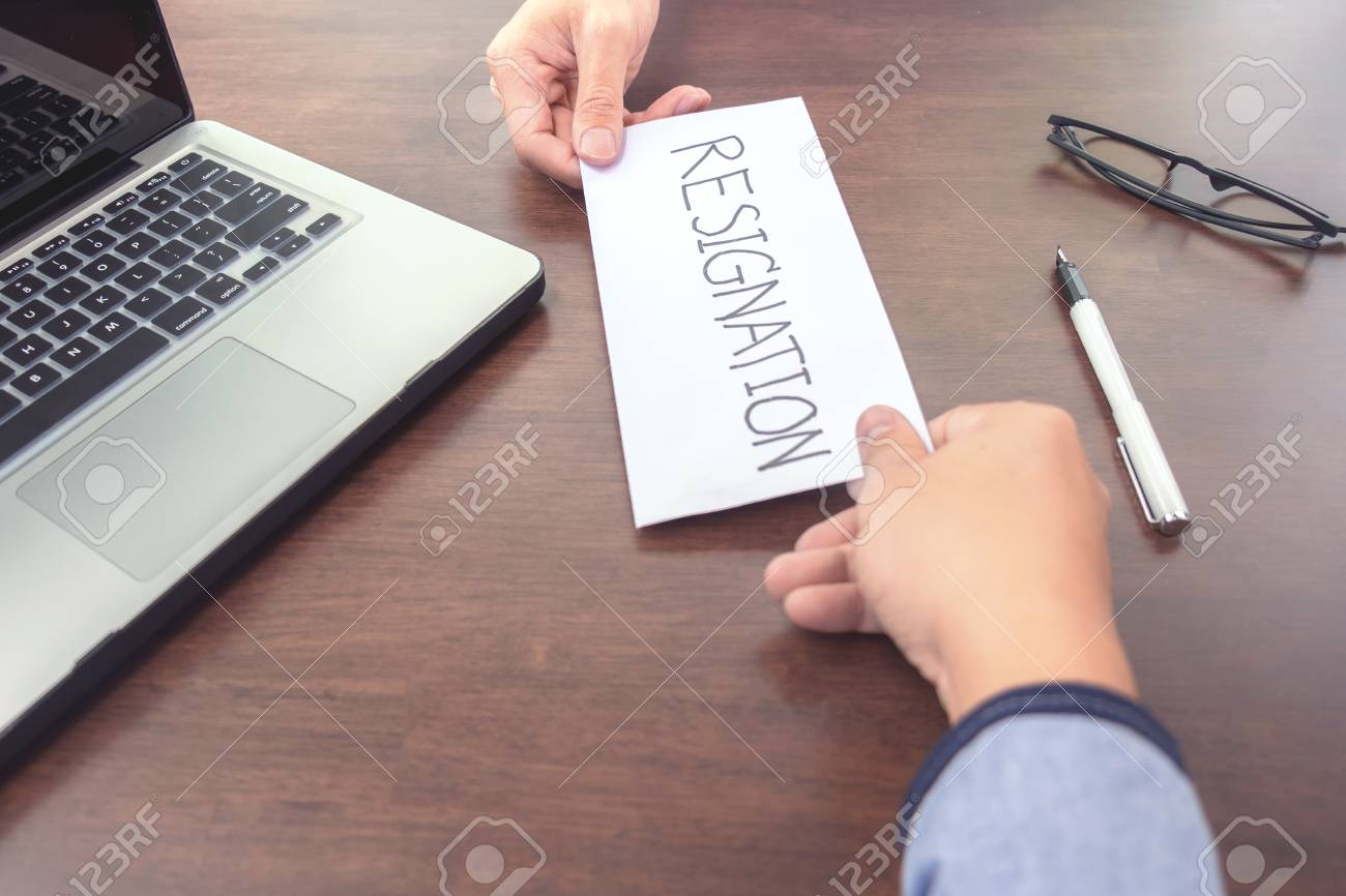 Image Of Businessman Hand Sending A Resignation Letter To Executive
