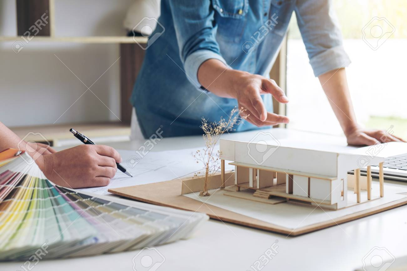 Two Young Women Interior Design Or Graphic Designer Working On