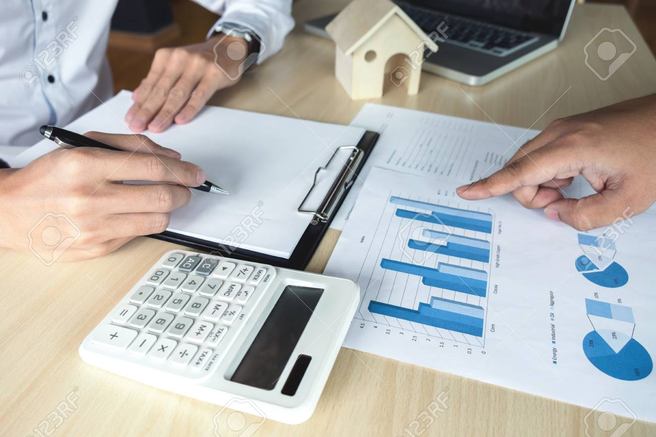 man sign a home insurance policy on home loans agent holds loan