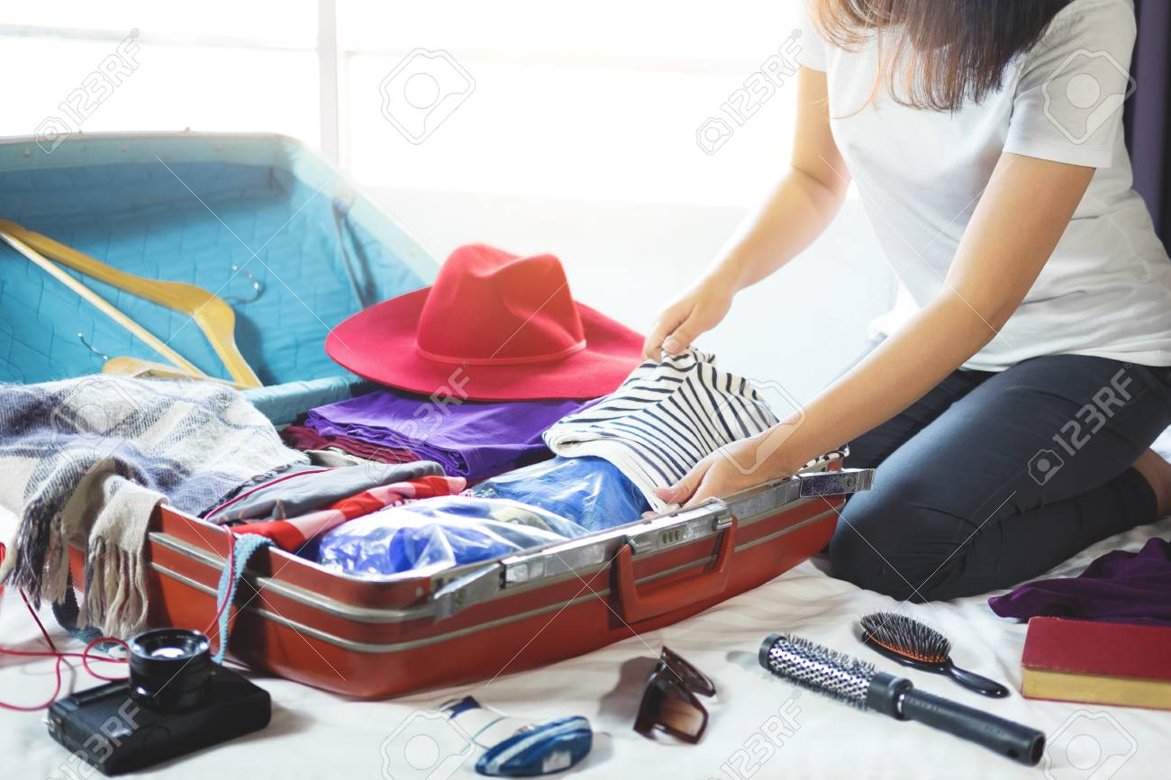 travel and vacation concept happiness young woman packing a stock